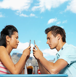 fecf62bd2860585e_cell_phone_couple.xlarge