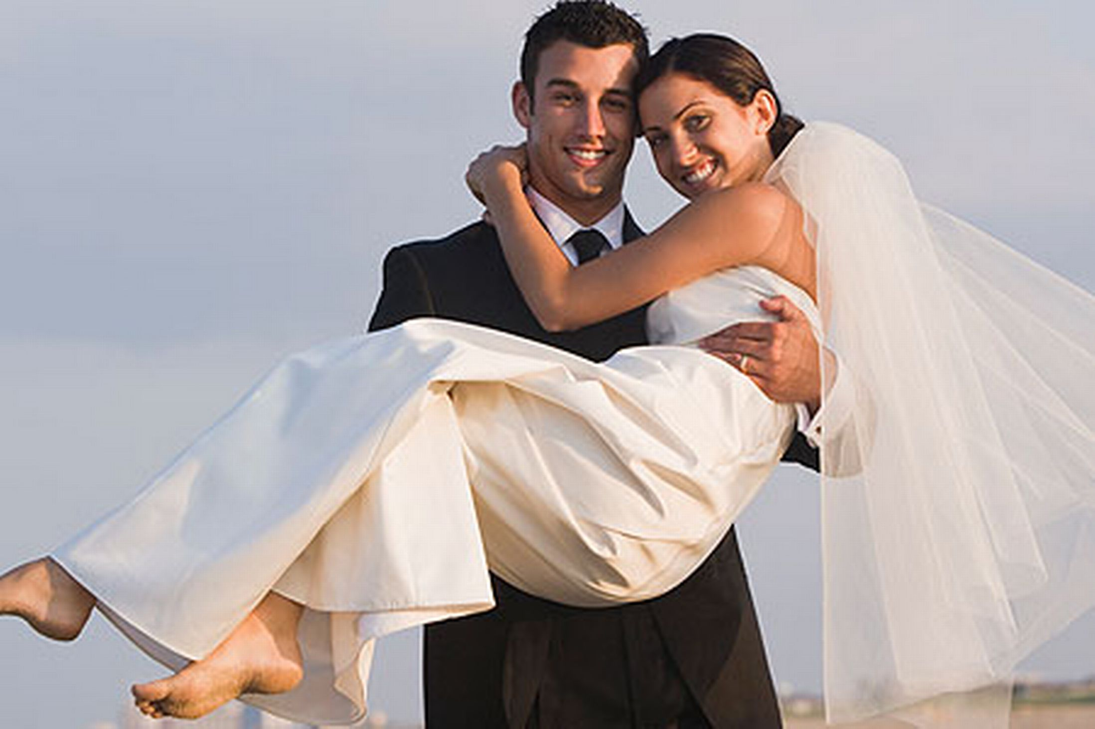 happy-newlyweds-at-beach-pic-getty-images-157588537
